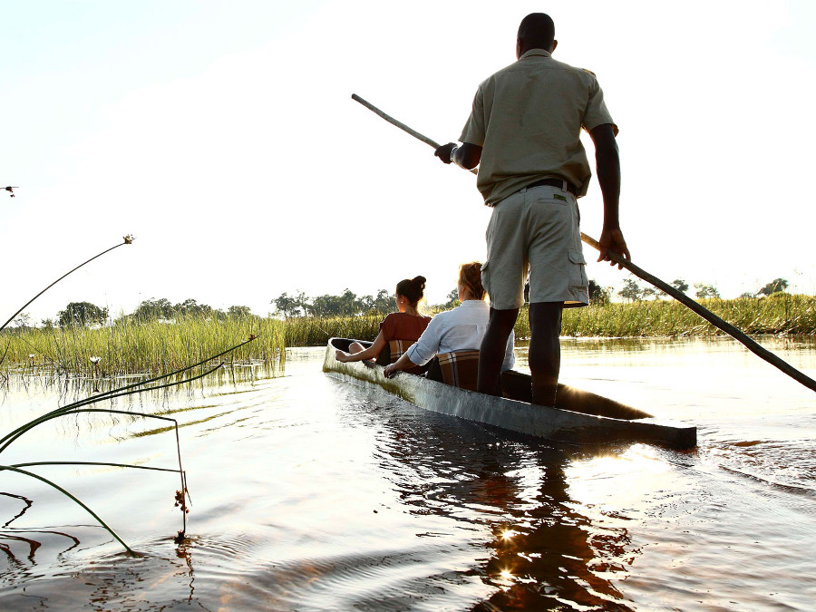 Canoe-Trip-with-traditional-mokoro-boat-on-the-river-through-Okavango-Delta