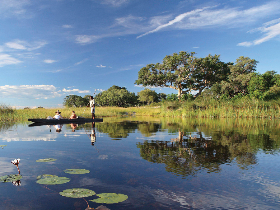 gliding-on-the-okavango-delta-in-a-mokoro-on-a-private-jet-expedition